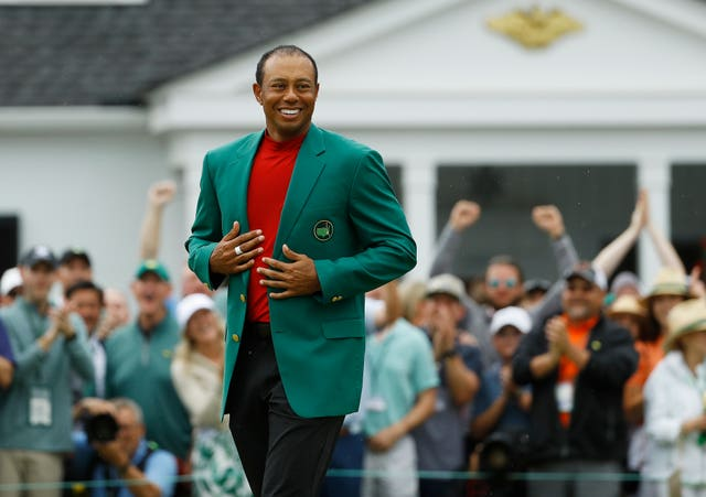 Masters champion Tiger Woods celebrates in the green jacket