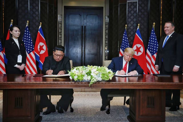 The US–North Korea summit signing ceremony in Singapore (Kevin Lim/The Straits Times/PA)