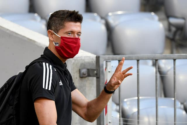 Robert Lewandowski arrives before the game
