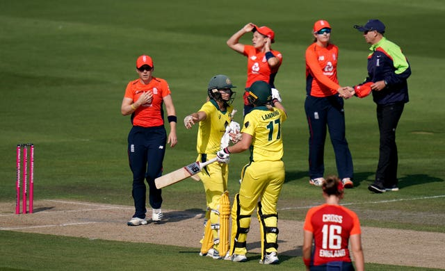 Australia's Ellyse Perry, centre left, and Meg Lanning celebrate another win over England in the Women's Ashes