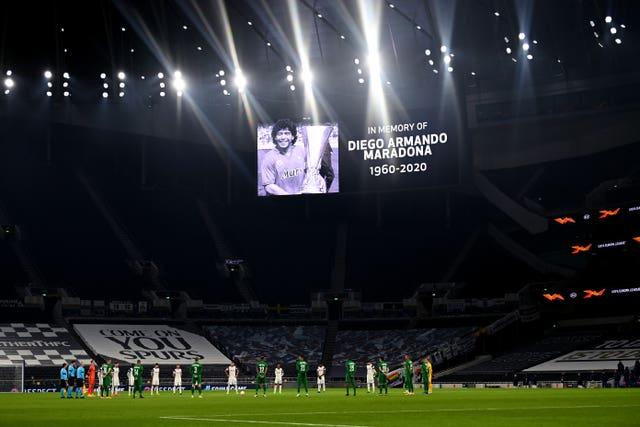 Players and officials observe a minute's silence at Tottenham Hotspur Stadium in memory of former Argentina player and manager Diego Maradona, who died on Wednesday