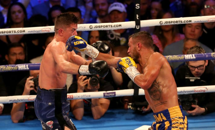 Luke Campbell, left, was outpointed by Vasyl Lomachenko (Steven Paston/PA)