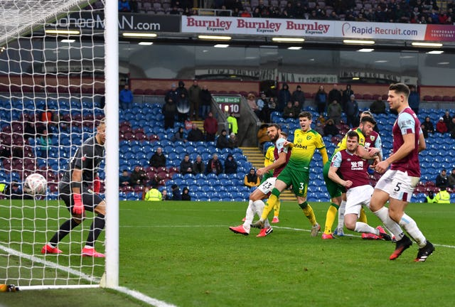 Grant Hanley, right, heads Norwich into the lead