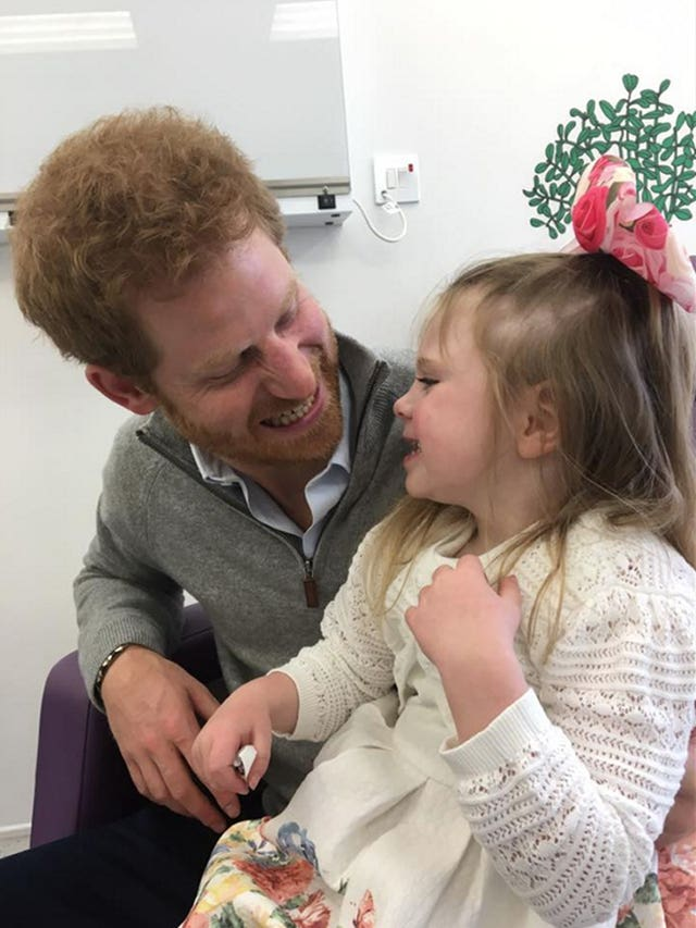 Prince Harry with Ollie Carroll