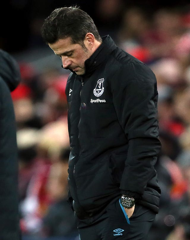 Marco Silva bows his head during Wednesday's defeat by Liverpool