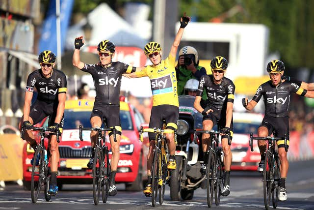 Team Sky's Chris Froome crossing the finish line on the final stage of his second Tour de France victory in 2015