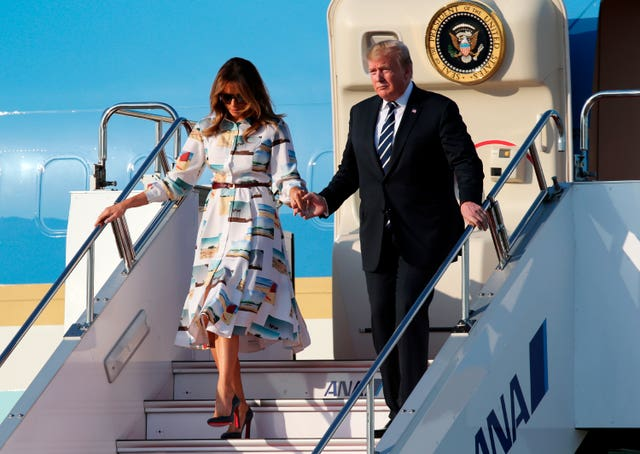 Donald and Melania Trump touch down in Tokyo