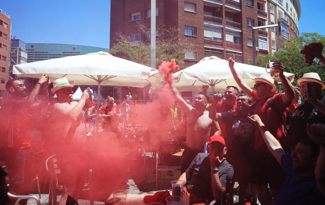 Liverpool fans set off a smoke flare in the Plaza de Felipe II