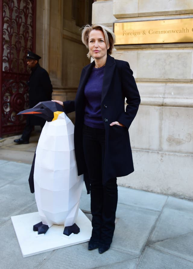 Gillian Anderson was joined by a penguin sculpture 'marching' for protection to deliver the Antarctic petition (David Mirzoeff/PA)
