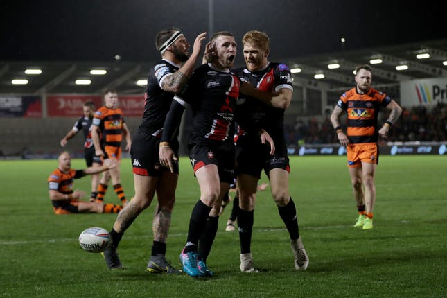 Jackson Hastings celebrates his try