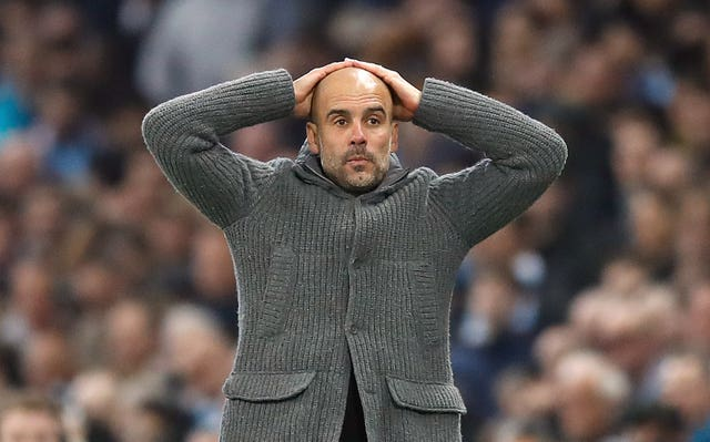 Pep Guardiola reacts after Raheem Sterling's injury-time winner against Tottenham is ruled out by VAR.