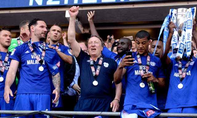 Neil Warnock celebrates winning promotion to the Premier League