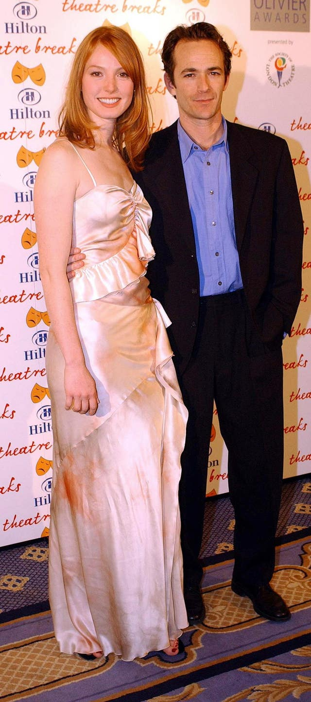 Luke Perry with US actress Alicia Witt at the Laurence Olivier Awards in 2004