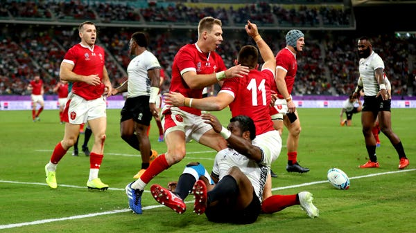Wales survive scare to beat Fiji and reach World Cup quarter-finals