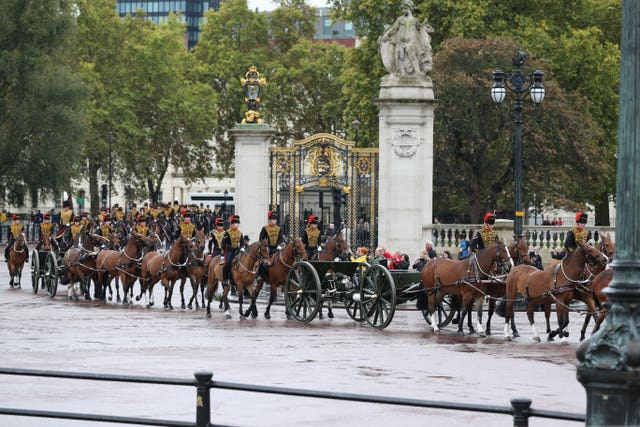 The King's Troop Royal Horse Artillery proceed past Buckingham Palace, London, ahead of the State Opening of Parliament