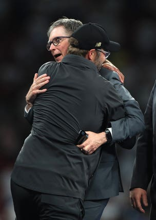 Fenway Sports Group's John Henry is embraced by Jurgen Klopp after Liverpool's Champions League victory