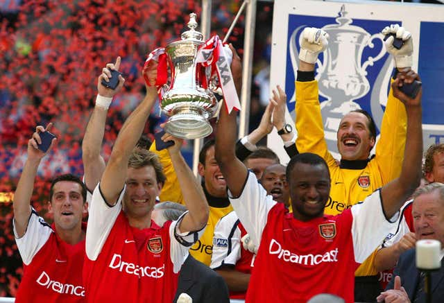 Tony Adams lifted the FA Cup as Arsenal completed the double with victory in Cardiff.