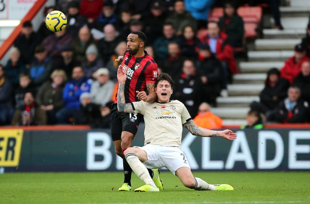 Bournemouth's Callum Wilson and Manchester United's Victor Lindelof battle for the ball