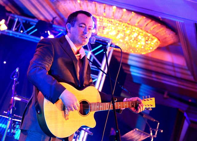 Michael Dugher  on guitar (Ian West/PA)