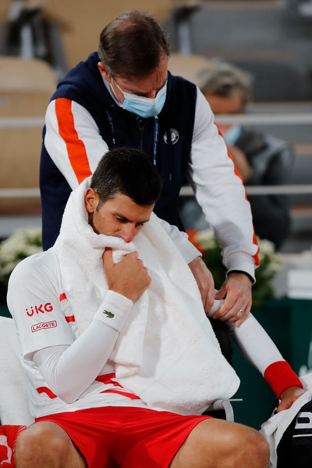 Novak Djokovic receives medical assistance during his victory over Pablo Carreno Busta