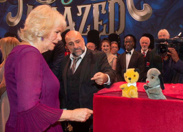 Camilla was pleased to meet her favourites Sooty and Sweep backstage at the end of the night. Julian Simmonds/The Daily telegraph