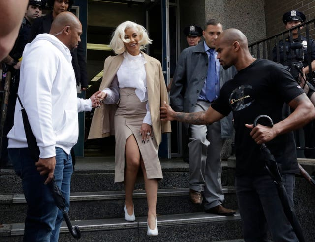 Cardi B leaves a police precinct in the Queens borough of New York