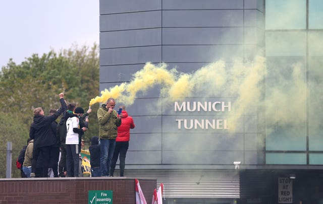 Manchester United fans let of yellow and green flares at Old Trafford