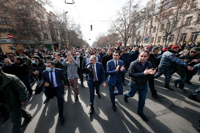 Armenian Prime Minister Nikol Pashinyan surrounded by his supporters