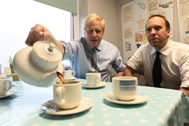 Prime Minister Boris Johnson takes a tea break with Health Secretary Matt Hancock during a visit to Bassetlaw District General Hospital in Worksop, Nottinghamshire