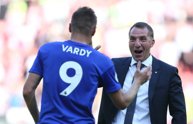 Jamie Vardy, left, is congratulated by Leicester boss Brendan Rodgers
