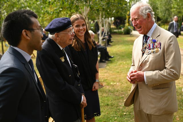 Charles chats to some veterans