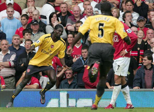 Emmanuel Adebayor (left) scored the last time Arsenal won at Old Trafford