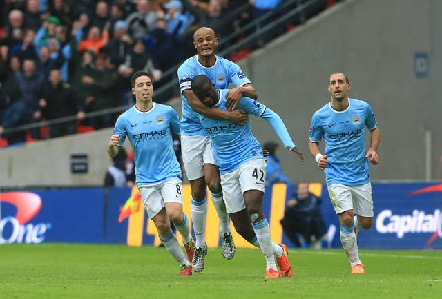 Yaya Toure is congratulated after scoring Manchester City's equaliser
