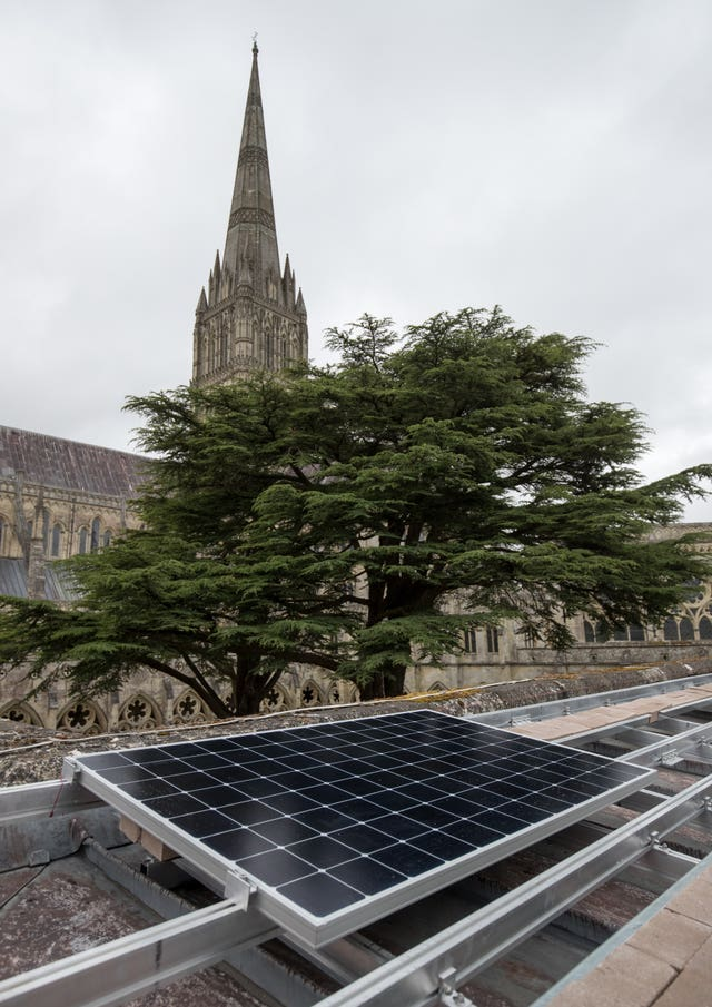 A solar panel is installed on the roof of Salisbury Cathedral's south cloister, (Andrew Matthews/PA)