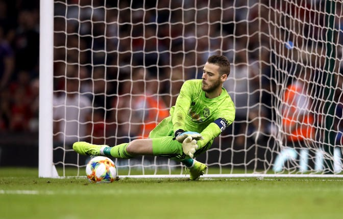 David De Gea makes the decisive save as Manchester United beat AC Milan on penalties in a pre-season game in Cardiff