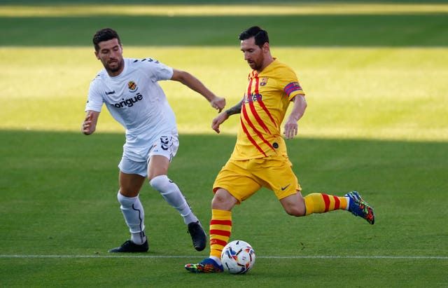 Messi wore the armband during the first half of Saturday's friendly against Gimnastic Tarragona