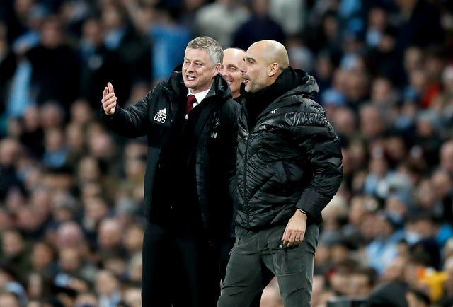 Manchester United manager Ole Gunnar Solskjaer (left) and Manchester City manager Pep Guardiola (right) will be hoping to earn bragging rights on Sunday.