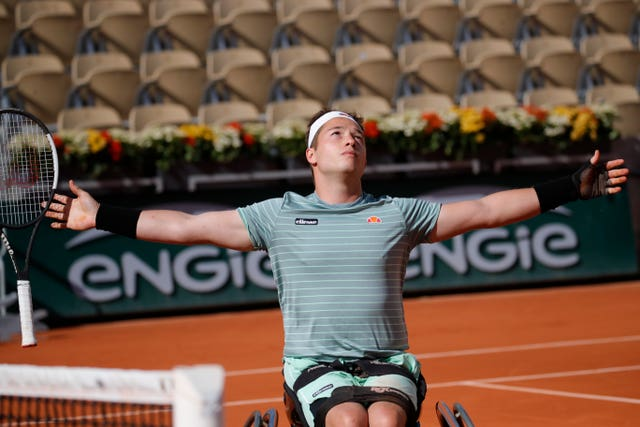 Alfie Hewett celebrates beating Joachim Gerard