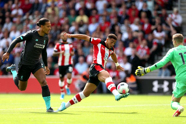 Che Adams, centre, shoots unsuccessfully against Liverpool