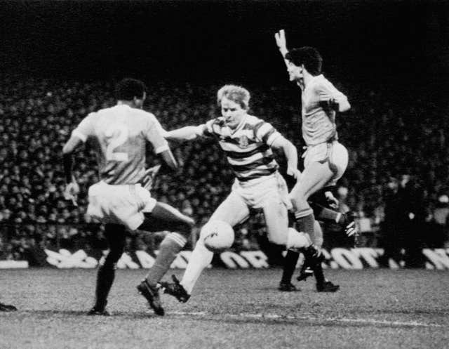 Murdo Macleod, centre, added a spectular late goal to seal victory for 10-man Celtic