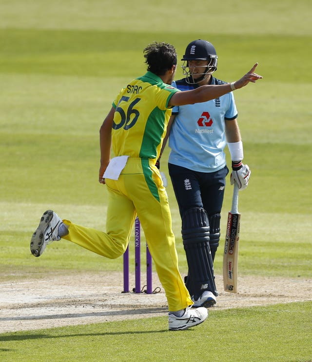 Mitchell Starc celebrates the dismissal of Joe Root