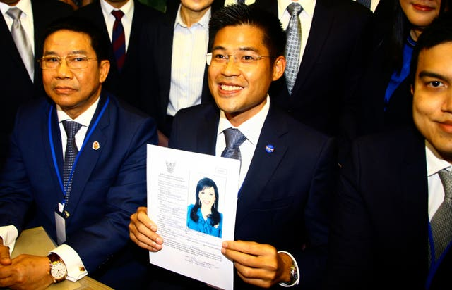 Leader of Thai Raksa Chart party Preecha Pholphongpanich holds a picture of Princess Ubolratana at election commission of Thailand