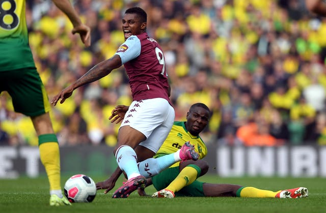 Norwich's Ibrahim Amadou tackles Wesley at Carrow Road
