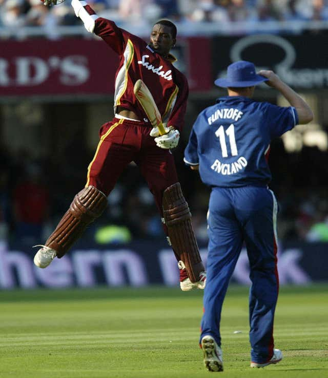 Chris Gayle, left, celebrates after leading the West Indies to victory at Lord's in 2004