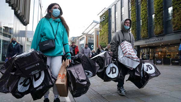 Shoppers return on 'Wild Wednesday' as England's lockdown ends