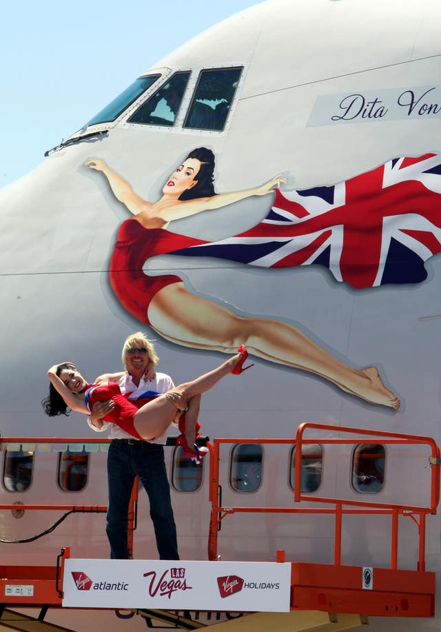 Sir Richard Branson and Dita Von Teese pose for photographers at McCarran International Airport, Las Vegas, USA in June 2010 (Steve Parsons/PA)