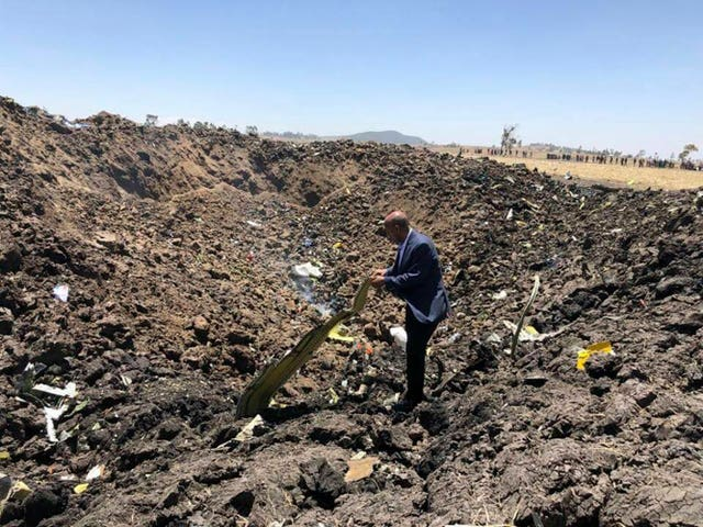 The chief executive of Ethiopian Airlines looks at the wreckage of the plane