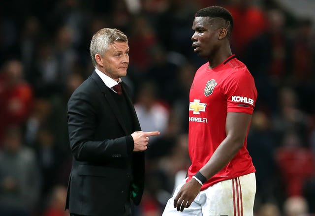 Ole Gunnar Solskjaer (left) now manages Pogba in United's first-team.