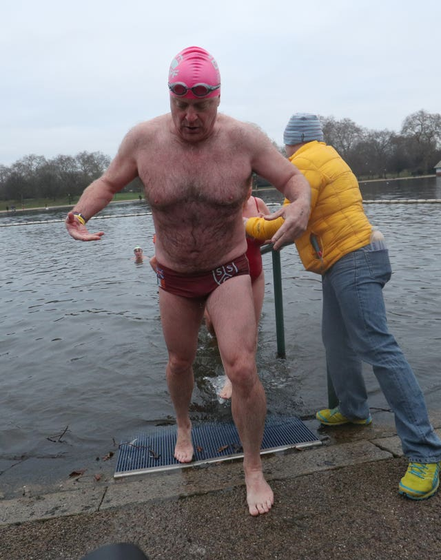 In Pictures Swimmers Brave The Elements For Christmas Day Dip The Irish News