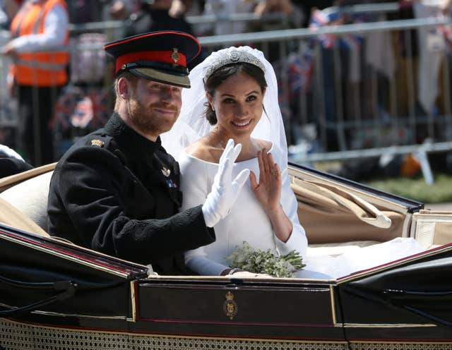 Harry and Meghan on a carriage ride through Windsor following their wedding